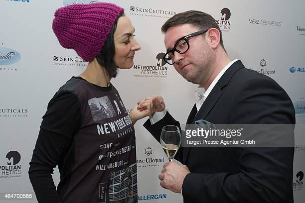 Cosmetic surgeon Christian Roessing and Marusha attend the Metropolitan Aesthetics Practice Opening on January 23 2014 in Berlin Germany