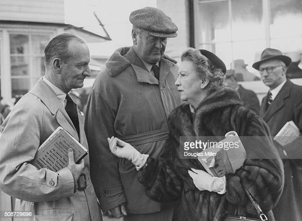 Cosmetics business woman Elizabeth Arden talking to the Queen's racehorse trainer Cecil BoydRochfort at the Newmarket Horse Sales where she brought a...