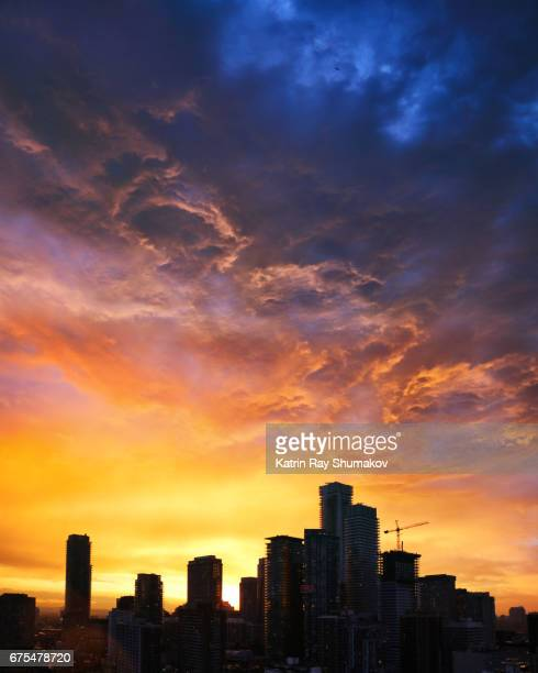 Cosmic Beauty of Sunset Above the Cityscapes