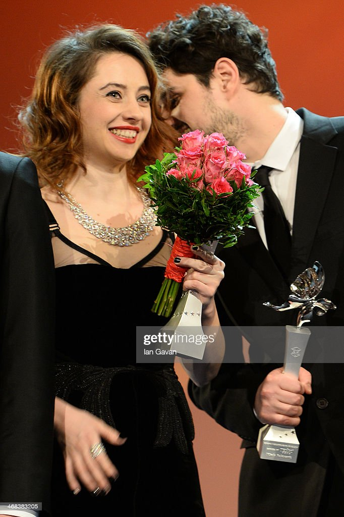Cosmina Stratan and Nikola Rakocevic on stage at the Shooting Stars stage presentation during the 64th Berlinale International Film Festival at the Berlinale Palast on February 10, 2014 in Berlin, Germany.