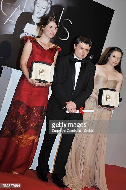 Cosmina Stratan Cristian Mungiu and Cristina Flutur pose at the Winners Photocall during the 65th Cannes International Film Festival
