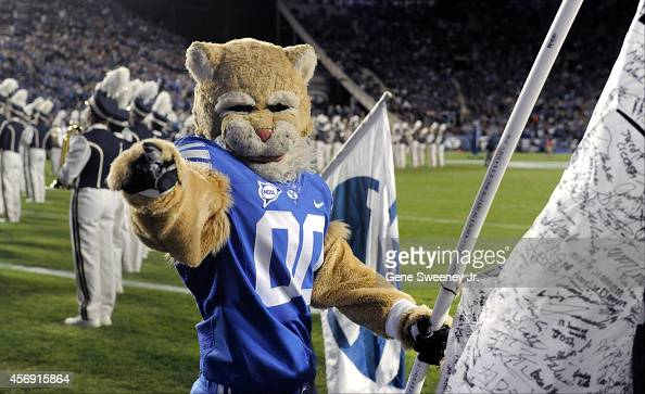 'Cosmo' the Brigham Young Cougars mascot welcomes the team on field before their game against the Utah State Aggies at LaVell Edwards Stadium on...