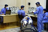 TOPSHOT Cosmonaut Anatoly Ivanishin of the Russian space agency Roscosmos looks on as his space suit is tested at the Russianleased Baikonur...