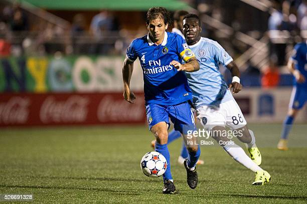NY Cosmos Captain Carlos Mendes goes for the goal against New York City FC player Kwame WatsonSiriboe the Soccer 2015 Lamar Hunt US Open Cup Fourth...