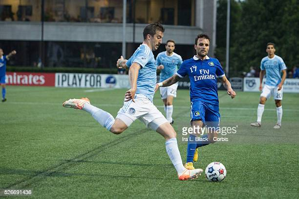 NY Cosmos player Ayoze Garcia Perez tries to get control of the ball against New York City FC player Jeb Brovsky during the Soccer 2015 Lamar Hunt US...
