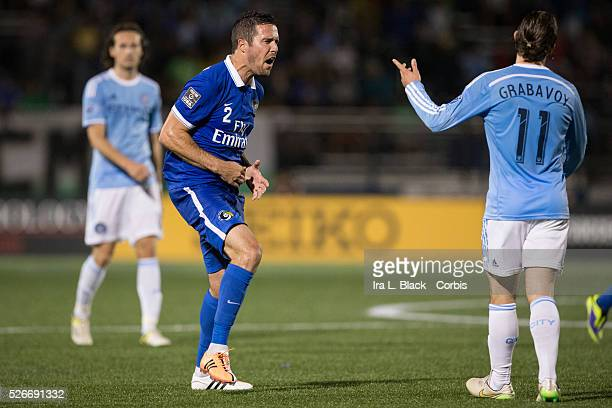 NY Cosmos player Hunter Freeman reacts to being hit by New York City FC player Ned Grabavoy during the Soccer 2015 Lamar Hunt US Open Cup Fourth...