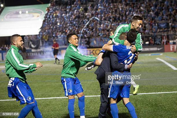 NY Cosmos player Hunter Gorskie gets mobbed by teammates after making the deciding penalty kick during the Soccer 2015 Lamar Hunt US Open Cup Fourth...