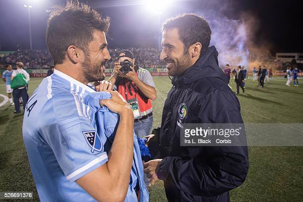 NY Cosmos player Raul exchanges shirts with New York City FC player David Villa after the Soccer 2015 Lamar Hunt US Open Cup Fourth Round New York...