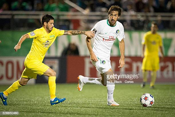 NY Cosmos player Raul tries to break away from Tampa Bay Rowdies' player during the Soccer 2015 NASL NY Cosmos vs Tampa Bay Rowdies match on April 18...