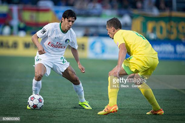 NY Cosmos player Walter Restrepo works past Tampa Bay Rowdies player during the Soccer 2015 NASL NY Cosmos vs Tampa Bay Rowdies match on April 18...