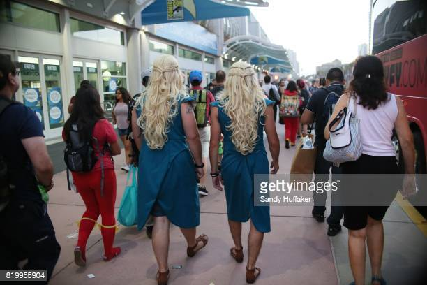 Cosplay characters dressed as Khaleesi from Game of Thrones walk outside the San Diego Convention Center during Comic Con International on July 20...