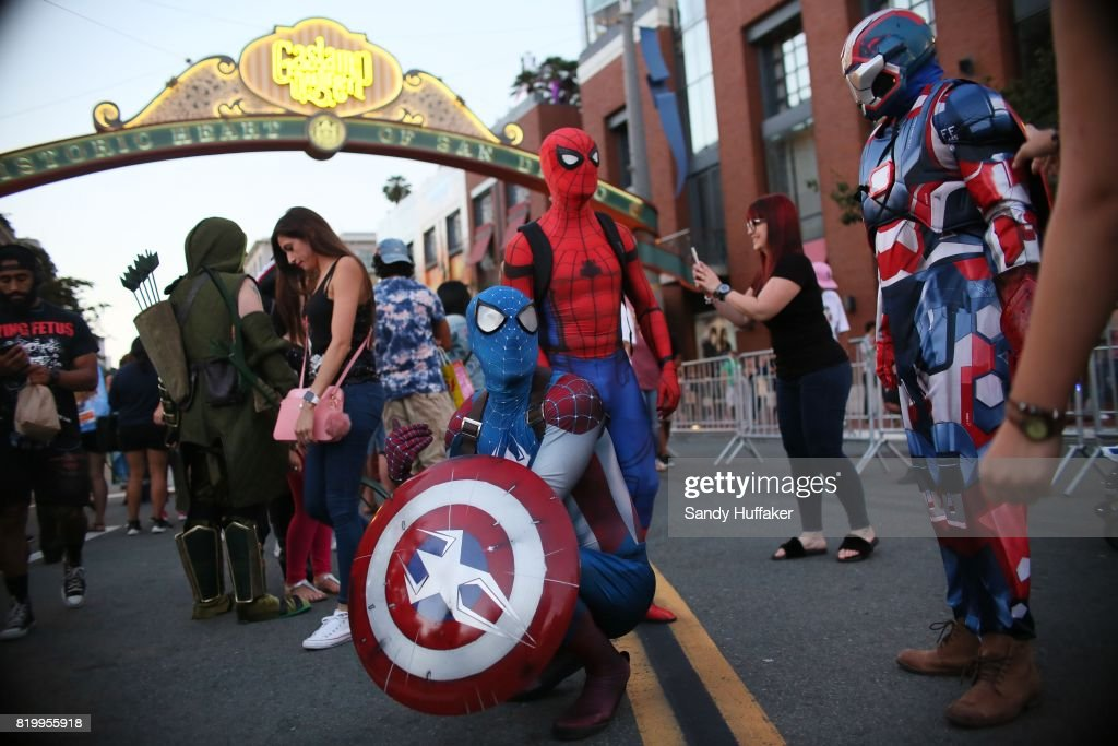 Cosplay characters dressed as Spiderman, pose for pictures along 5th Avenue in the Gaslamp Quarter during Comic Con International on July 20, 2017 in San Diego, California. Comic Con International is North America's largest Comic convention featuring pop culture and entertainment elements across virtually all genres, including horror, animation, anime, manga, toys, collectible card games, video games, webcomics, and fantasy novels as well as movie premieres and actor panels.
