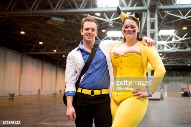 A cosplay couple in character as Ash Ketchum and Pikachu during the MCM Birmingham Comic Con at NEC Arena on March 19 2017 in Birmingham England