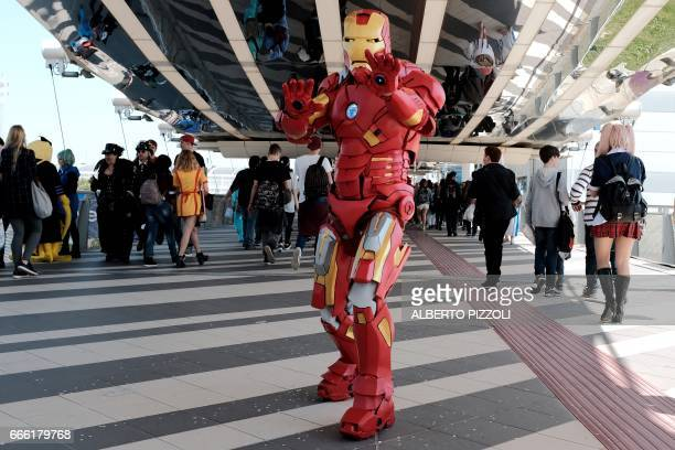 A cosplay enthusiast dressed up as Iron Man comic super hero poses during the Romics event a comic book and gaming convention in Rome on April 8 2017...