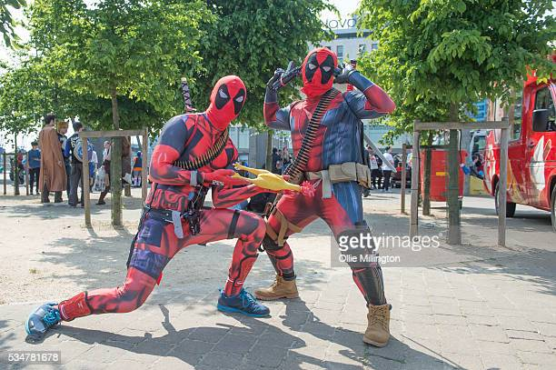 Cosplay enthusiasts as Deadpool on Day 1 of MCM London Comic Con at The London ExCel on May 27 2016 in London England