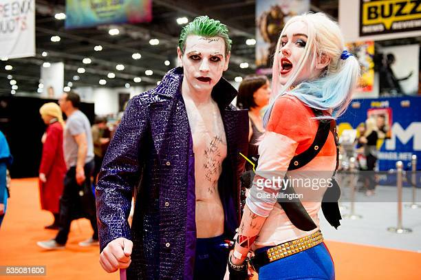 Cosplay enthusiasts dressed as Harley Quinn and The Joker seen on Day 2 of MCM London Comic Con at The London ExCel on May 28 2016 in London England