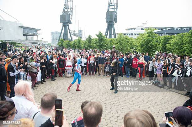 A cosplay enthusiasts dressed as Spiderman engaging people in a dance off on Day 2 of MCM London Comic Con at The London ExCel on May 28 2016 in...