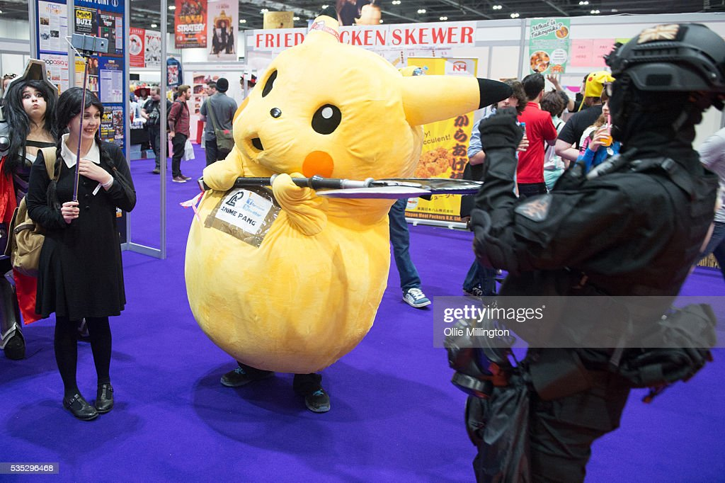 Cosplay enthusiasts in costume play fight with a Pikachu on Day 1 of MCM London Comic Con at The London ExCel on May 27, 2016 in London, England.