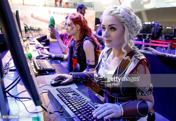 Cosplay enthusiasts try out a virtual reality game at the Gamescom 2017 gaming trade fair on August 22 2017 in Cologne Germany Gamescom is the...