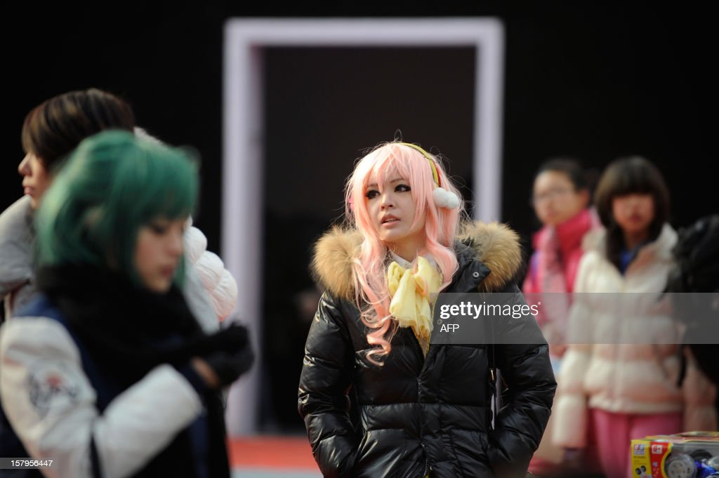 A 'cosplay' fan (C) attends the International Anime Fair in Beijing on December 8, 2012. The fair is being held at the Beijing Crab Island International Convention and Exhibition Centre from December 1 to 9.