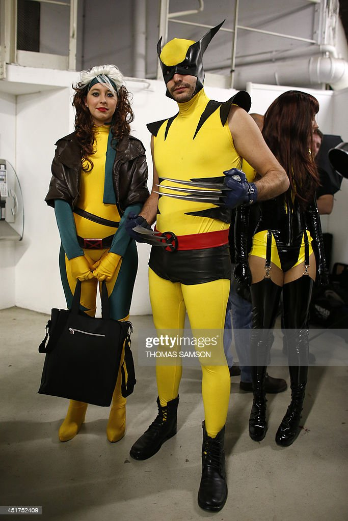 A cosplay fan dressed as 'Wolverine' (R) poses with other fans as they take part in a contest on November 24, 2013 during the 'Paris Comics Expo' at the Espace Champerret in Paris. Organised by Pixidol association, this contest of cosplay (short for 'costume play') marks the 50th anniversary of Marvel Comics' X-Men and The Avengers.