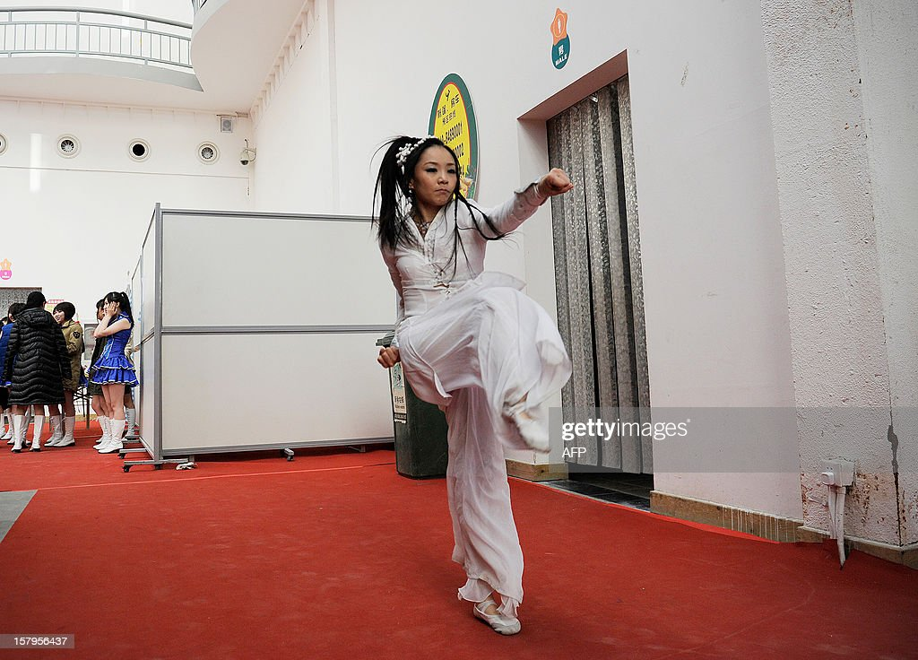 A 'cosplay' fan practices kung fu while backstage before a show during the International Anime Fair in Beijing on December 8, 2012