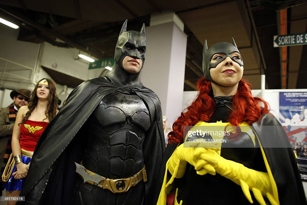 Cosplay fans dressed as Batman and Batgirl take part in a contest on November 24, 2013 during the 'Paris Comics Expo' at the Espace Champerret in Paris. Organised by Pixidol association, this contest of cosplay (short for 'costume play') marks the 50th anniversary of Marvel Comics' X-Men and The Avengers.