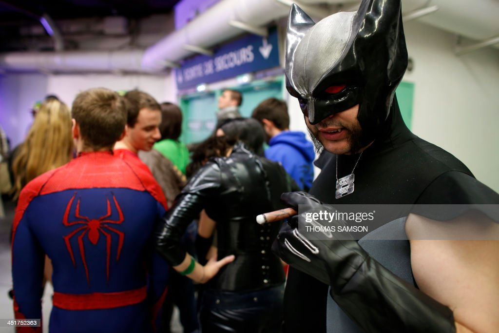 Cosplay fans line up as they take part in a contest on November 24, 2013 during the 'Paris Comics Expo' at the Espace Champerret in Paris. Organised by Pixidol association, this contest of cosplay (short for 'costume play') marks the 50th anniversary of Marvel Comics' X-Men and The Avengers.