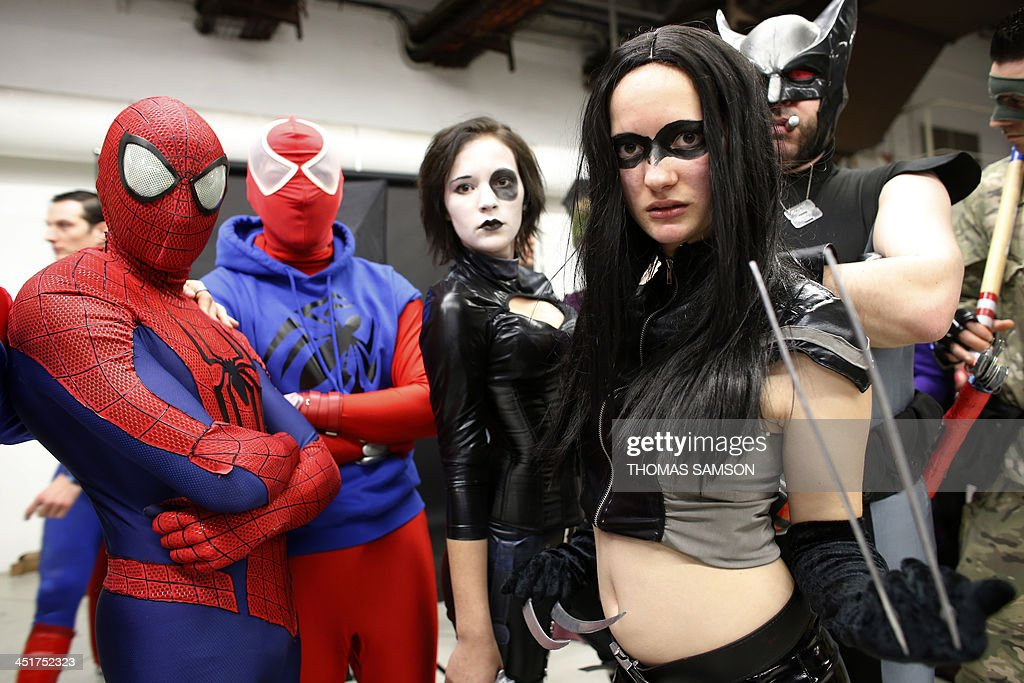 Cosplay fans pose as they take part in a contest on November 24, 2013 during the 'Paris Comics Expo' at the Espace Champerret in Paris. Organised by Pixidol association, this contest of cosplay (short for 'costume play') marks the 50th anniversary of Marvel Comics' X-Men and The Avengers.