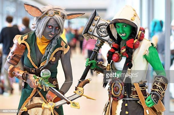 'Cosplay' fans pose for a photo as they attend the Leipzig Book Fair on March 14 2015 The Leipzig book fair hosts 2263 exhibitors from 42 countries...