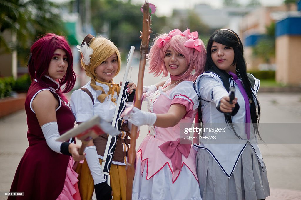 Cosplay fans pose for pictures during the Halloween Fan Fest party at the International Fairs and Conventions Centre in San Salvador on October 20...