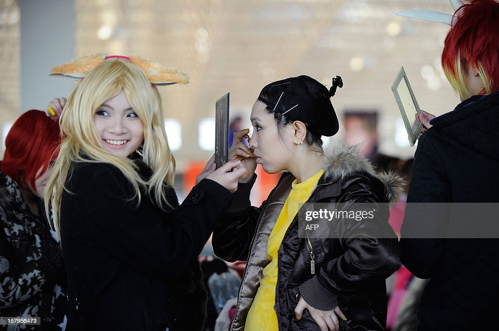 'Cosplay' fans prepare for a show at the International Anime Fair in Beijing on December 8, 2012. The fair is being held at the Beijing Crab Island International Convention and Exhibition Centre from December 1 to 9.