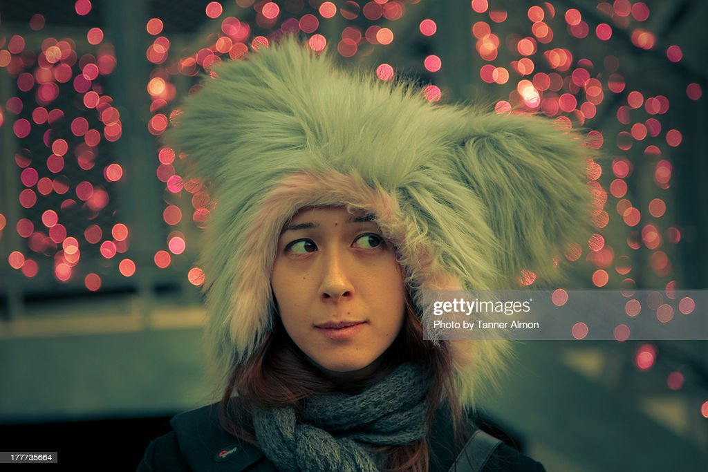 Cosplay girl wears furry hat with pink lights