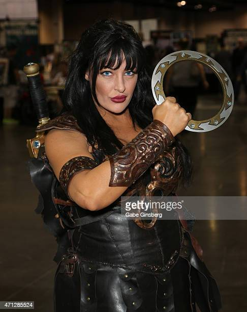 Cosplay model and costume designer Aime Jaze dressed as the character Xena from the 'Xena Warrior Princess' television show attends Wizard World...
