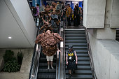 SAN DIEGO CA FRIDAY JULY 22 2016 A cosplay Rancor from Star Wars decends an escalator in pieces as it makes an appearance at Comic Con 2016 at the...