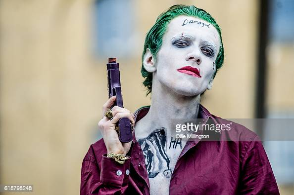 A cosplayer as The Joker from Suicide Squad poses on day 1 of the MCM London Comic Con at ExCel on October 28 2016 in London England