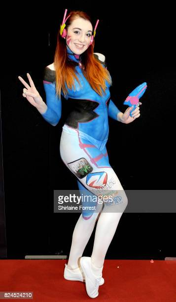 A cosplayer bodypainted as D Va of Overwatch attends MCM Comic Con at Manchester Central on July 30 2017 in Manchester England