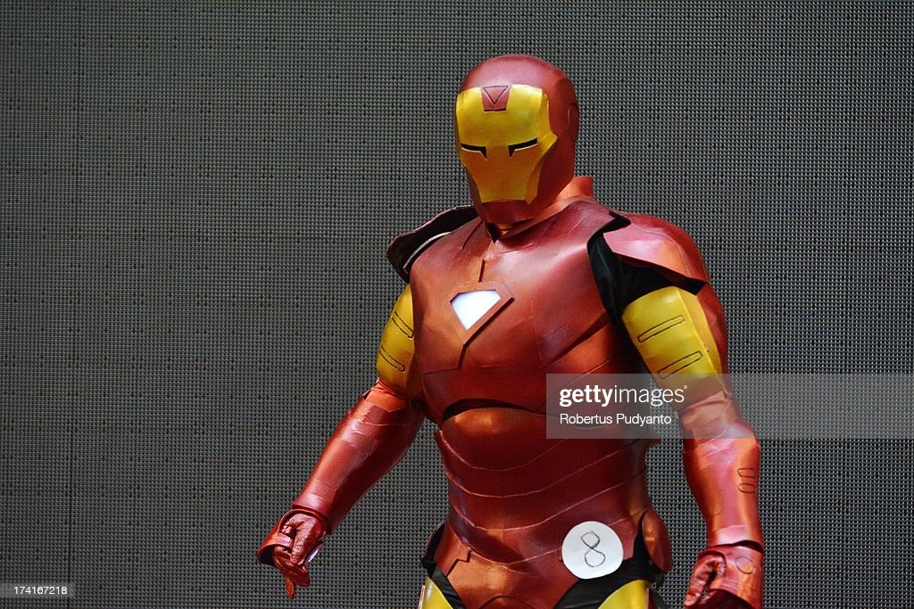 Cosplayer contestants dressed as Iron Man performs in Cosplay Competition at Grand City Mall on July 21 2013 in Surabaya Indonesia Cosplayers put on...