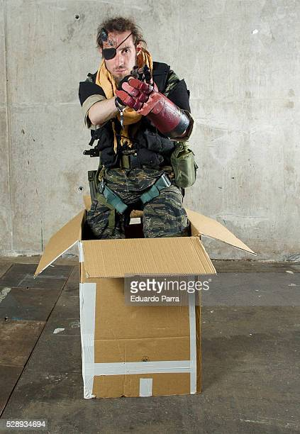 Cosplayer @diabloinfernus characterized as the Big Boss character of the video game 'Metal Gear Solid V' attends the fair Expomanga at IFEMA on May...