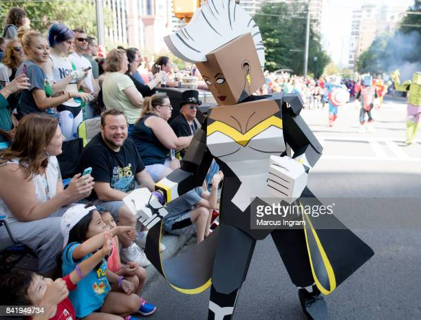 Cosplayer dressed as a Boxed Hero Storm greet fans at the 2017 DragonCon Parade on September 2 2017 in Atlanta Georgia DragonCon is a multimedia...