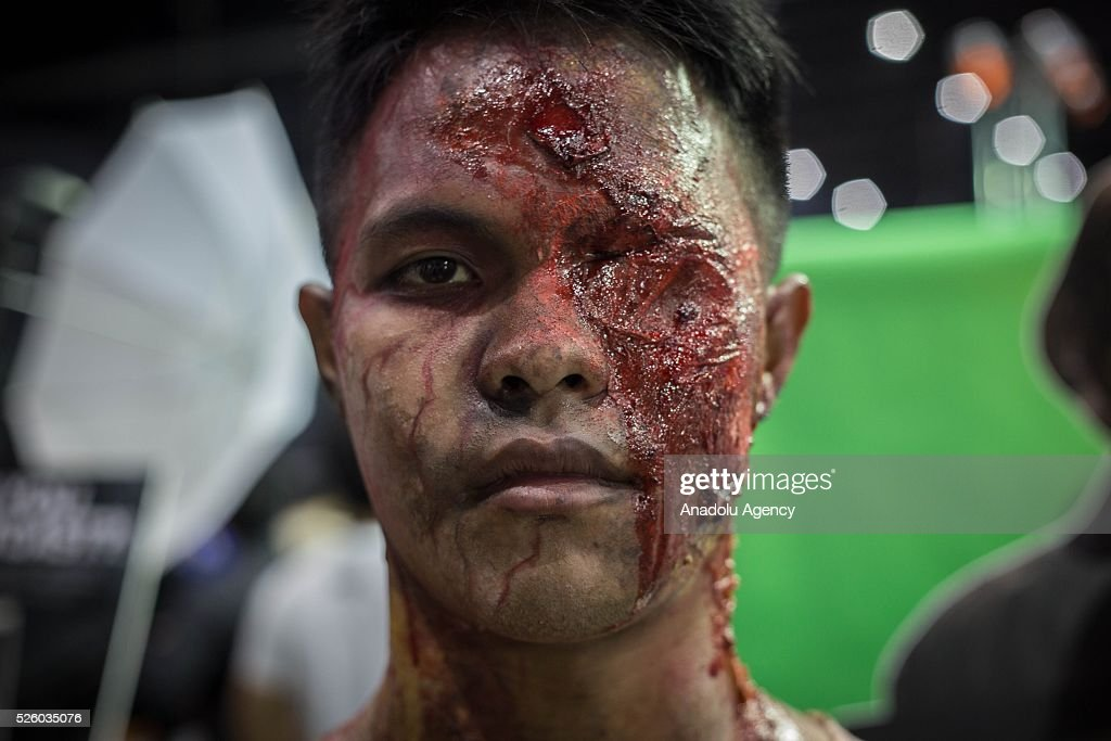 A cosplayer dressed as a zombie from the movie series 'The Walking Dead' poses for a picture during the Bangkok Comic Con 2016 Festival at Bitec Exhibition Centre in Bangkok, Thailand on April 29, 2016. 'Cosplay' imitates characters from comics, video games, anime series and science fiction movies, mostly coming from the Japanese pop culture. Bangkok Comic Con is one of the biggest Pop Culture exhibition in Asia starts from 29 April until 1 May 2016. The event hopes to turn Thailand into a major center for international filmmakers and animators come to create their masterpieces. Comic Con is an internationally renowned event in the world of animation as it started in 1970 in San Diego.
