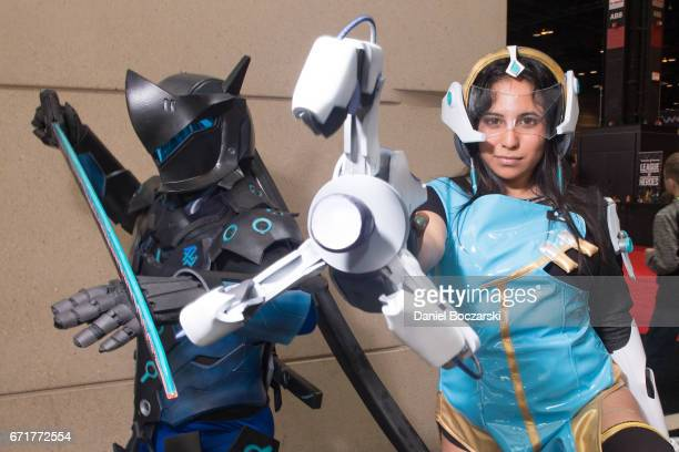 Cosplayer dressed as characters from 'Overwatch' attend C2E2 Chicago Comic and Entertainment Expo McCormick Place on April 22 2017 in Chicago Illinois