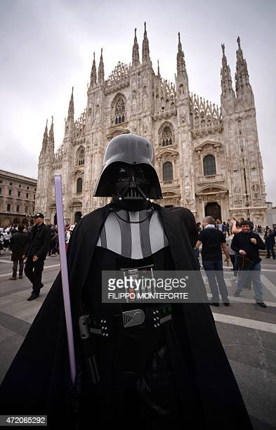 A cosplayer dressed as Darth Vader of 'Star Wars' stands in front of Milan's Duomo on May 3 2015 as part of Star Wars Day AFP PHOTO / FILIPPO...