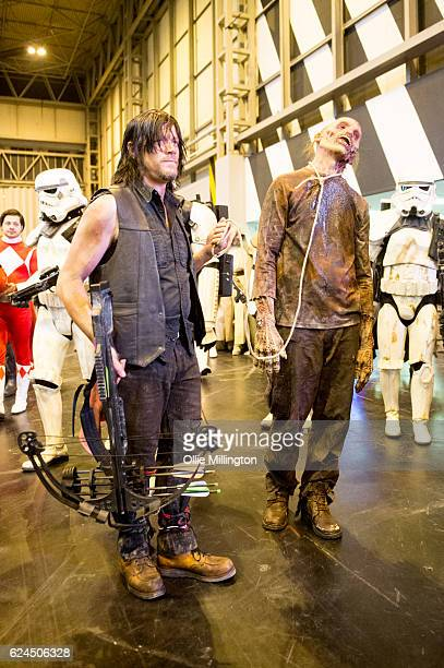 A cosplayer dressed as Daryl Dixon with a pet Zombie surrounded by Stormtroopers during day 1 of the November Birmingham MCM Comic Con at the...