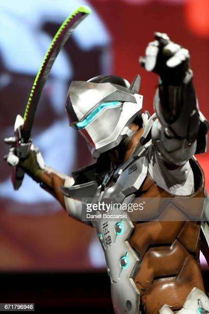 A cosplayer dressed as Genji from 'Overwatch' attends the C2E2 Crown Champions of Cosplay at McCormick Place on April 22 2017 in Chicago Illinois