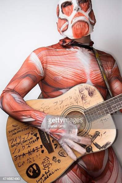 Cosplayer dressed as guitar playing zombie attends MCM Comic Con at ExCel convention centre in London England on May 23 2015
