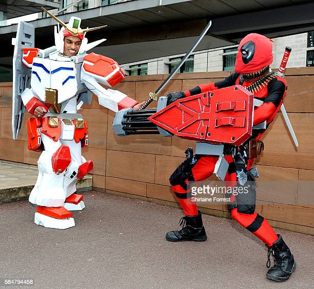 Cosplayer dressed as Gundam Heavyarms and Deadpool attend MCM Comic Con at Manchester Central on July 30 2016 in Manchester England