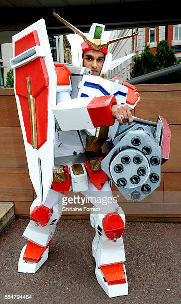 Cosplayer dressed as Gundam Heavyarms attends MCM Comic Con at Manchester Central on July 30 2016 in Manchester England
