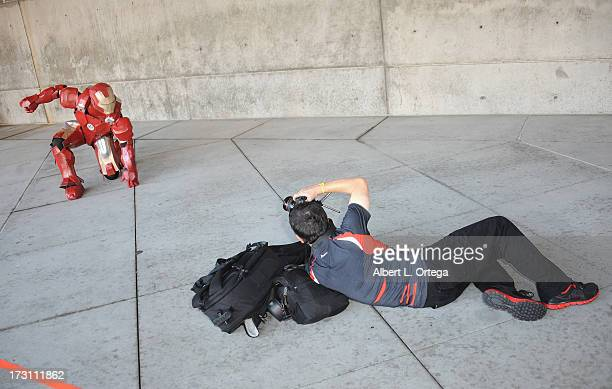 Cosplayer dressed as Iron Man attends the Anime Expo 2013 held at The Los Angeles Convention Center on July 6 2013 in Los Angeles California