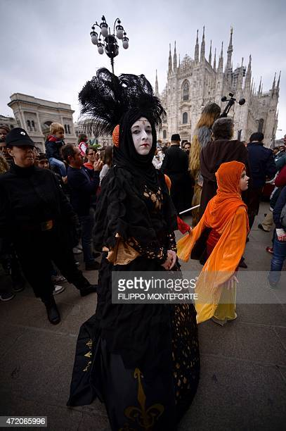 A cosplayer dressed as Padme Amidala of 'Star Wars' stands in front of Milan's Duomo on May 3 2015 as part of Star Wars Day AFP PHOTO / FILIPPO...